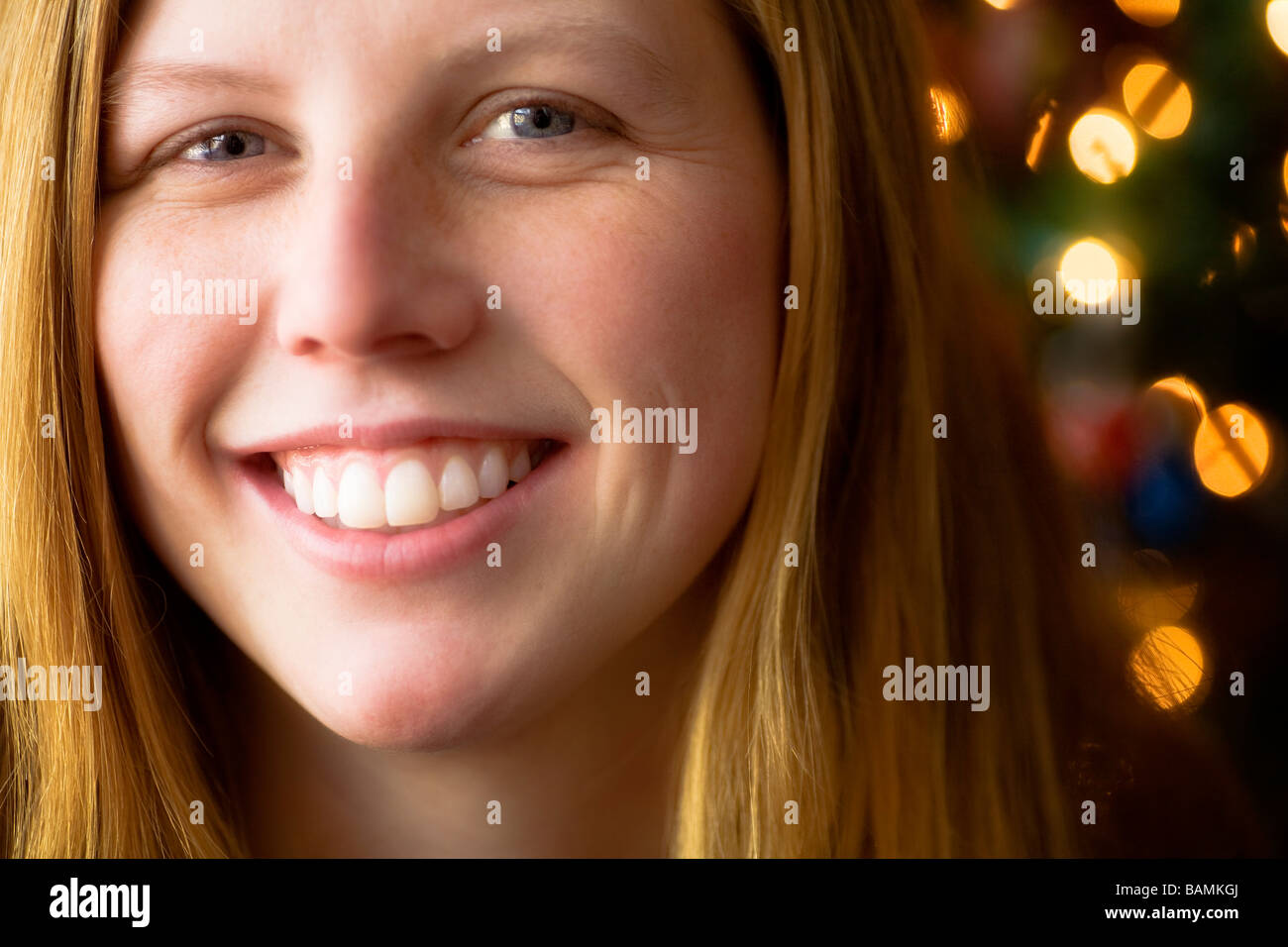 Portrait of woman with lights in background - Stock Image