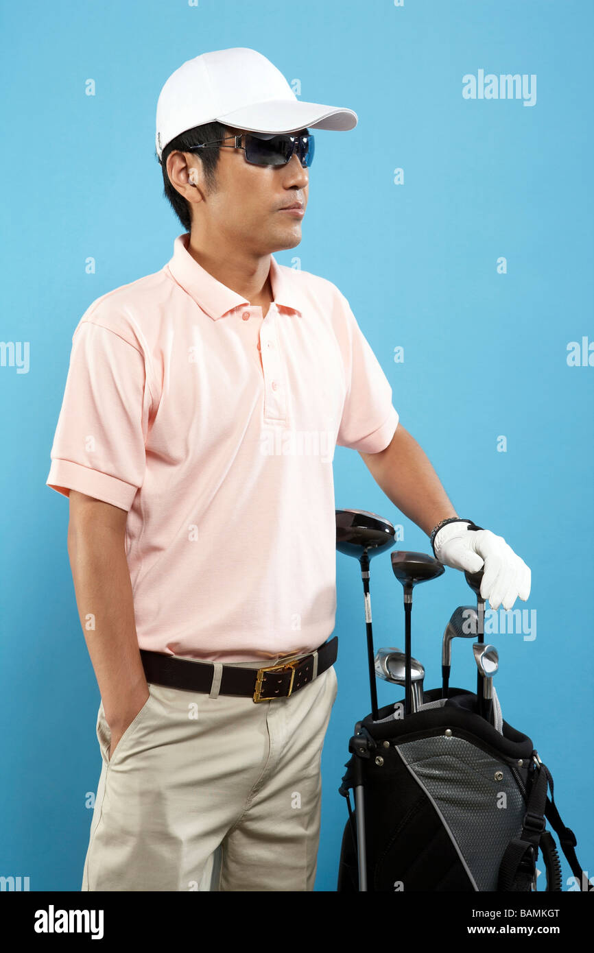 Male Golfer Ready To Tee Off - Stock Image