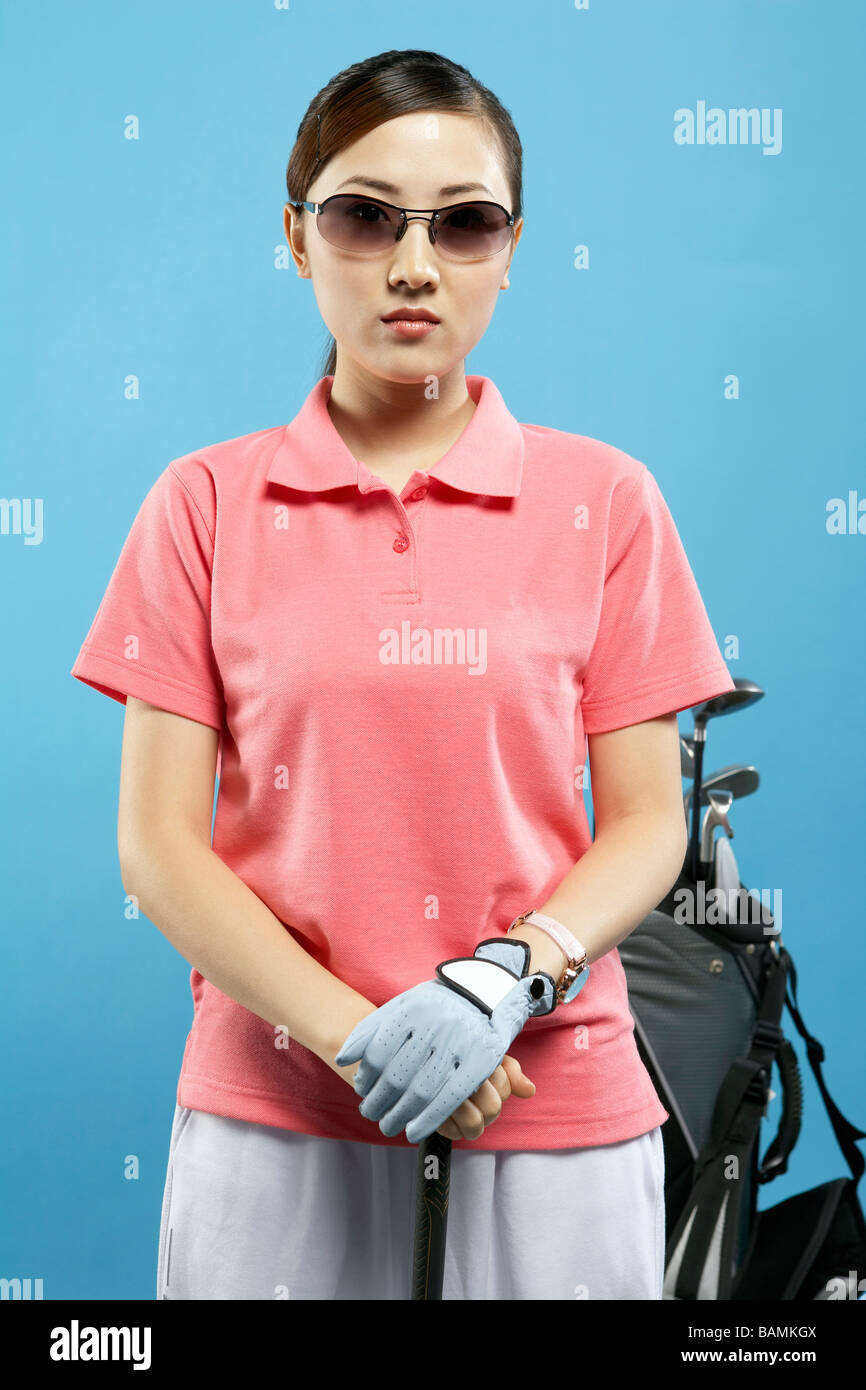Woman Golfer Waiting Her Turn To Tee Off - Stock Image