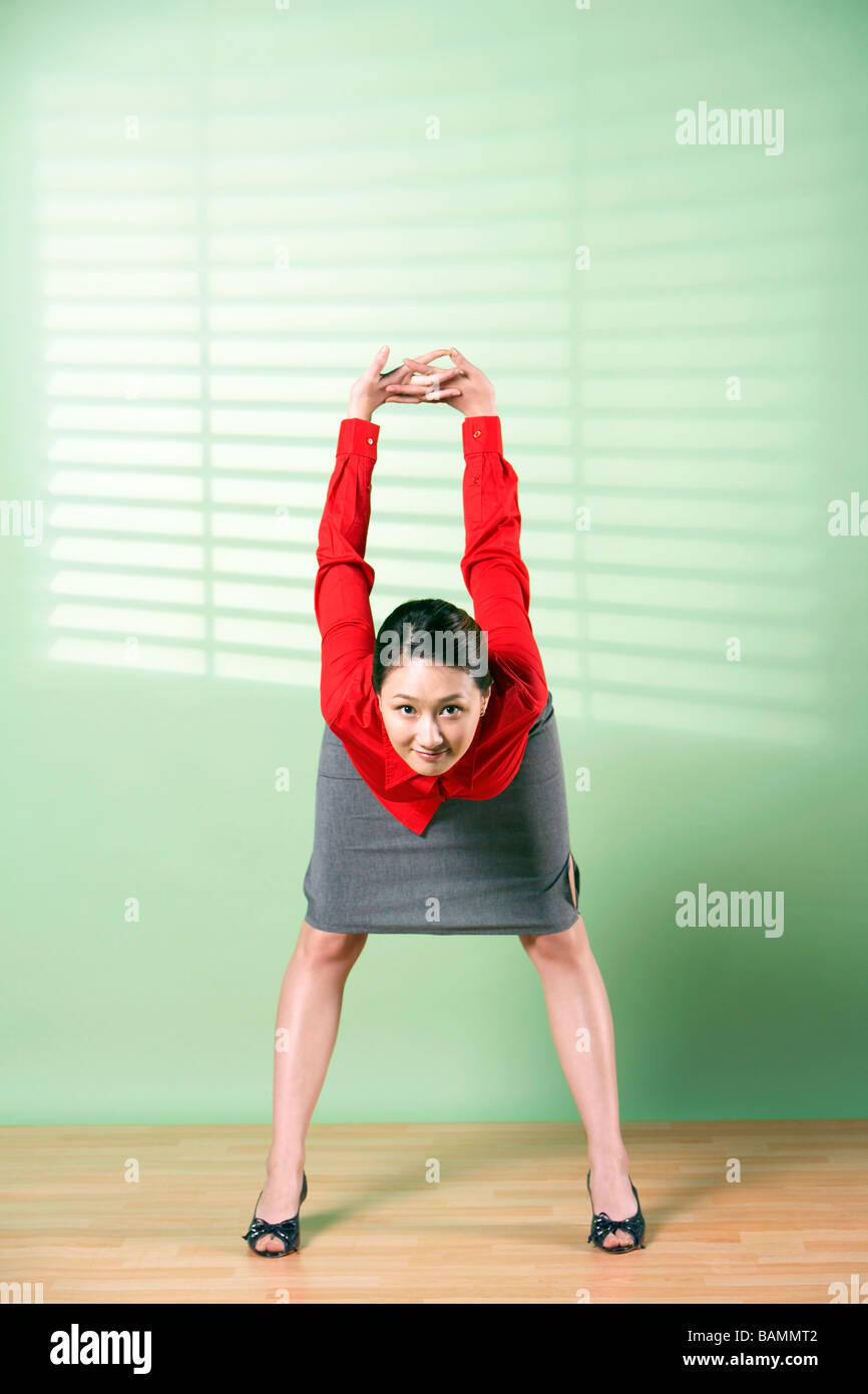 Businesswoman Stretching - Stock Image