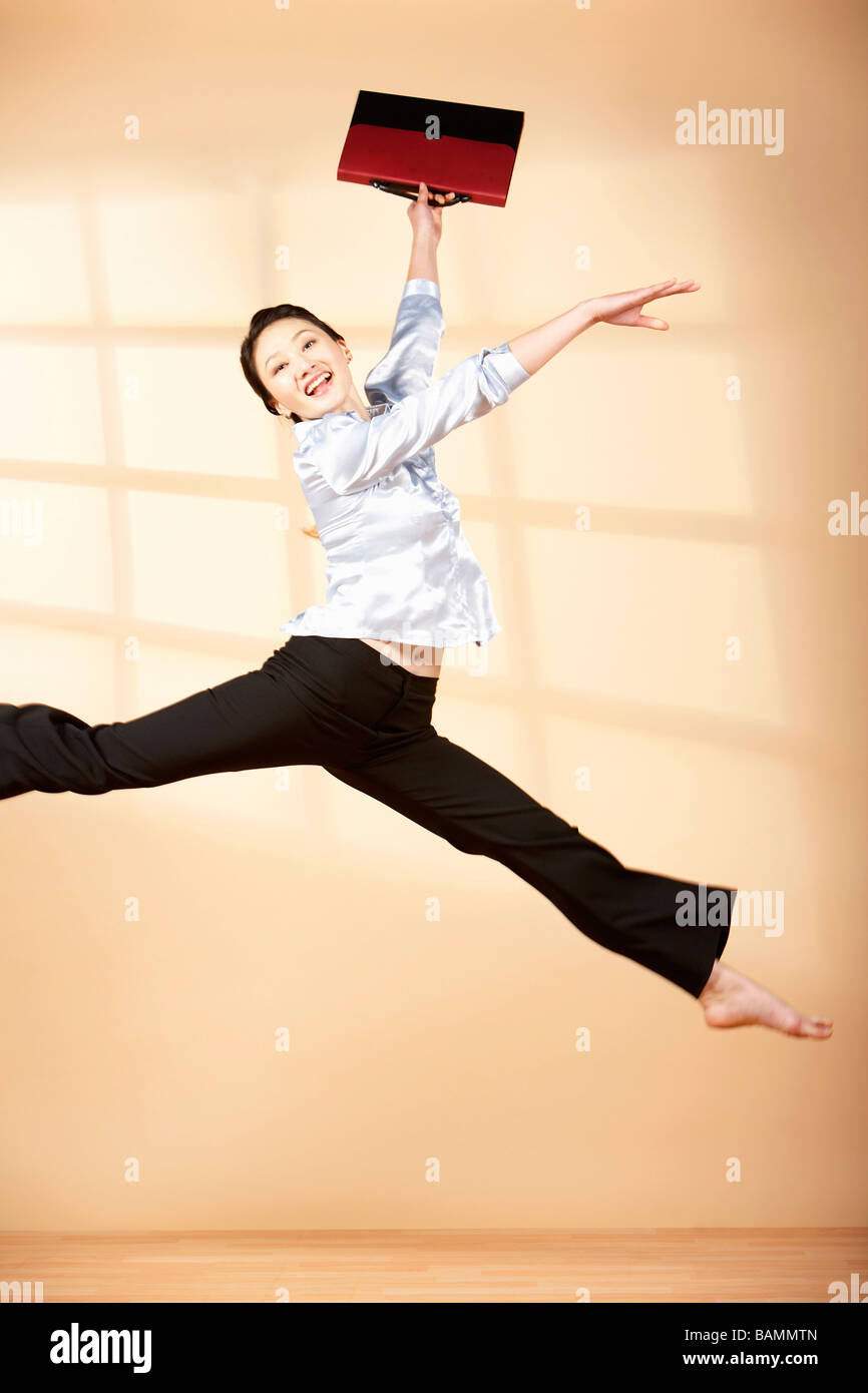 Woman Leaping In The Air - Stock Image