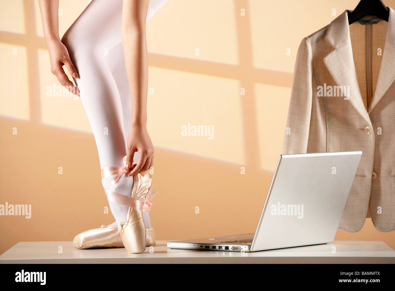 Ballet Dancer Tying Up Pointe Shoes - Stock Image