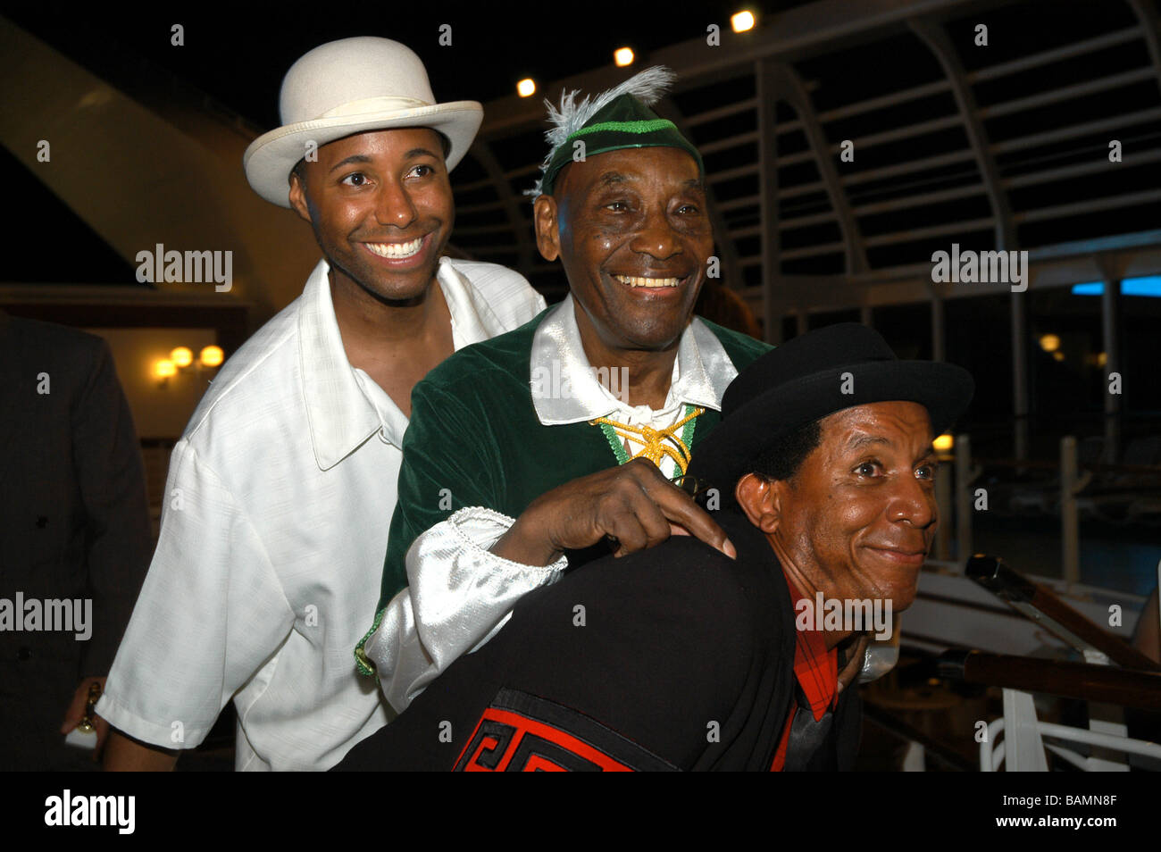 Frankie Manning, with Ryan Francois (left) and Steven Mitchell (right) on Frankie's 90th birthday cruising the - Stock Image