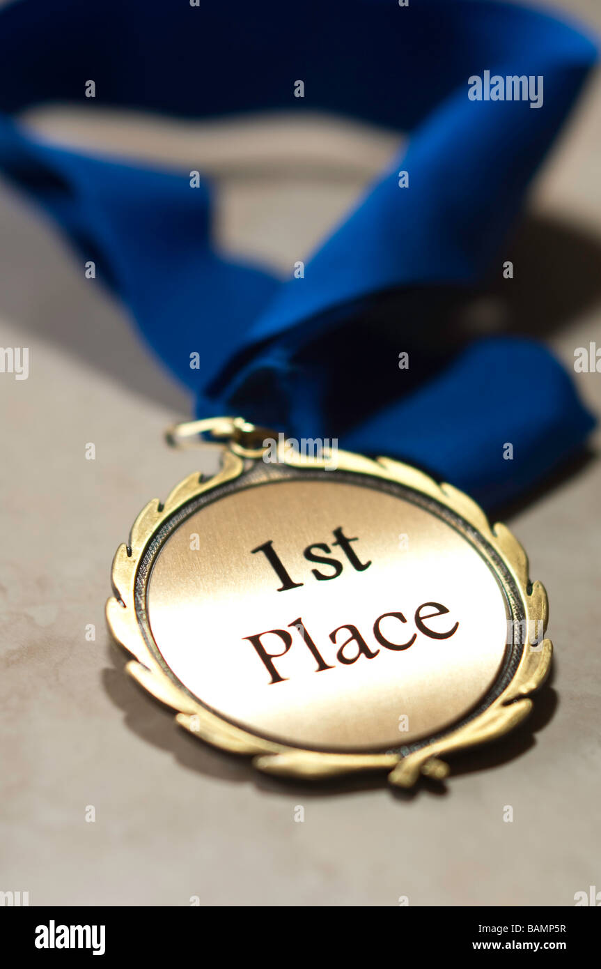First place medal with blue ribbon - Stock Image