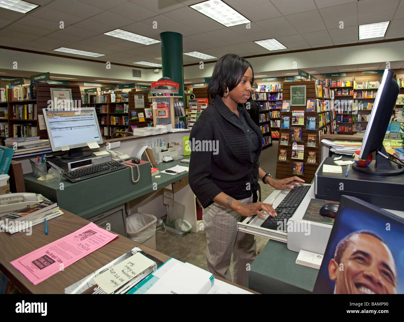 Worker at University of Chicago Bookstore - Stock Image