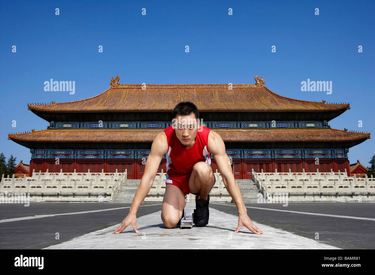 Portrait Of Athlete In Front Of Temple - Stock Image