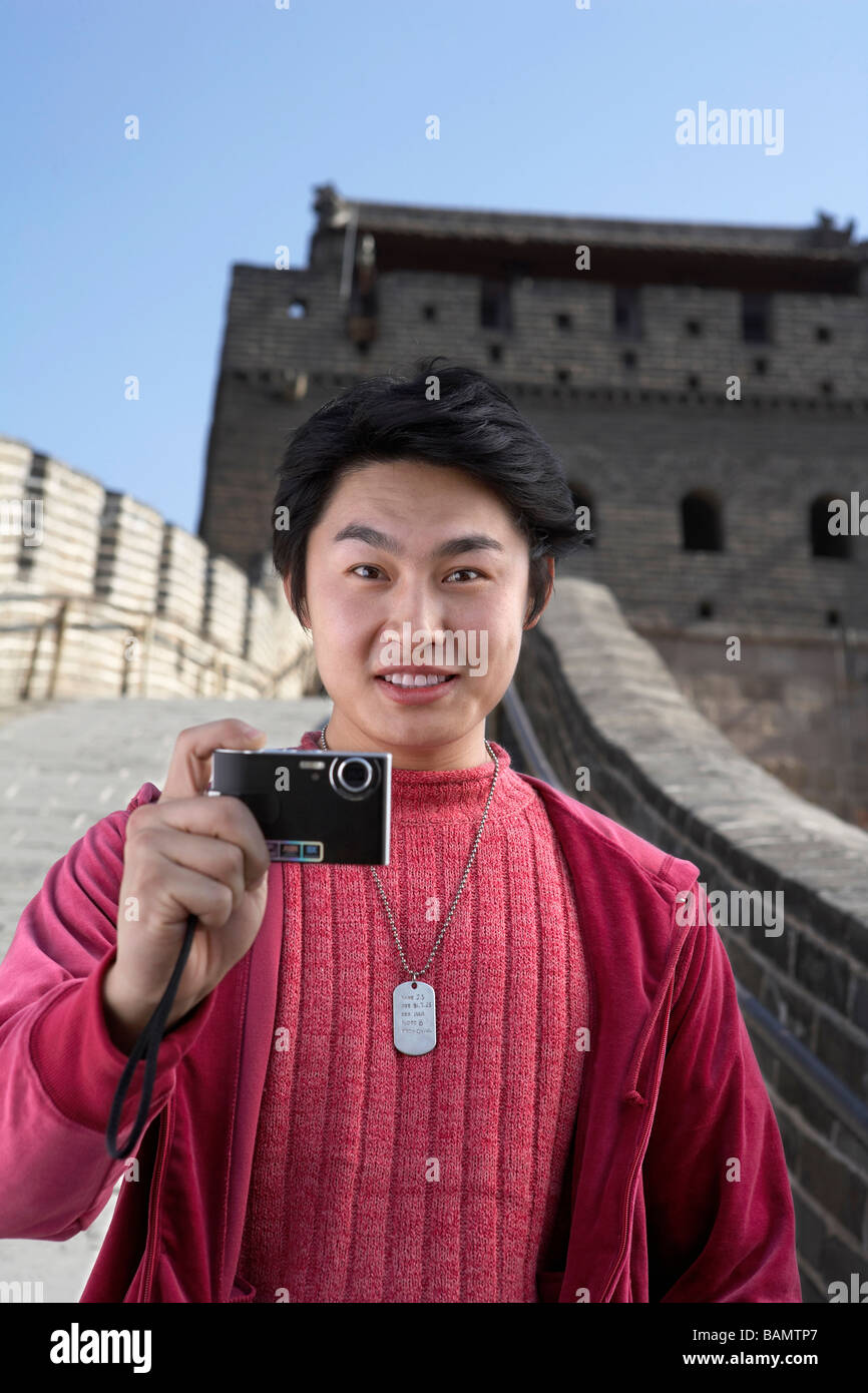 Young Man Taking A Picture On The Great Wall Of China - Stock Image