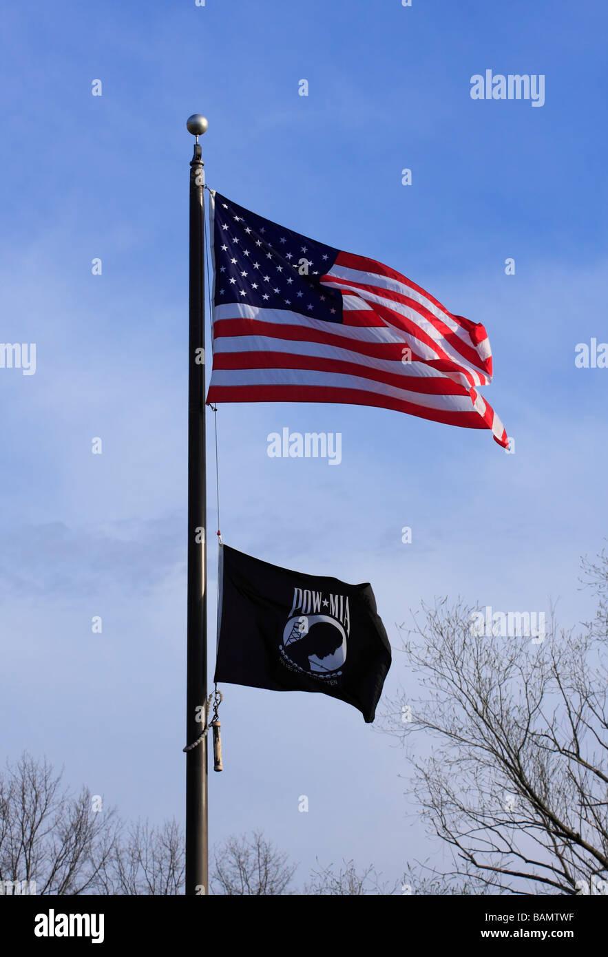 United States and P.O.W. M.I.A. Flag on flagpole. - Stock Image