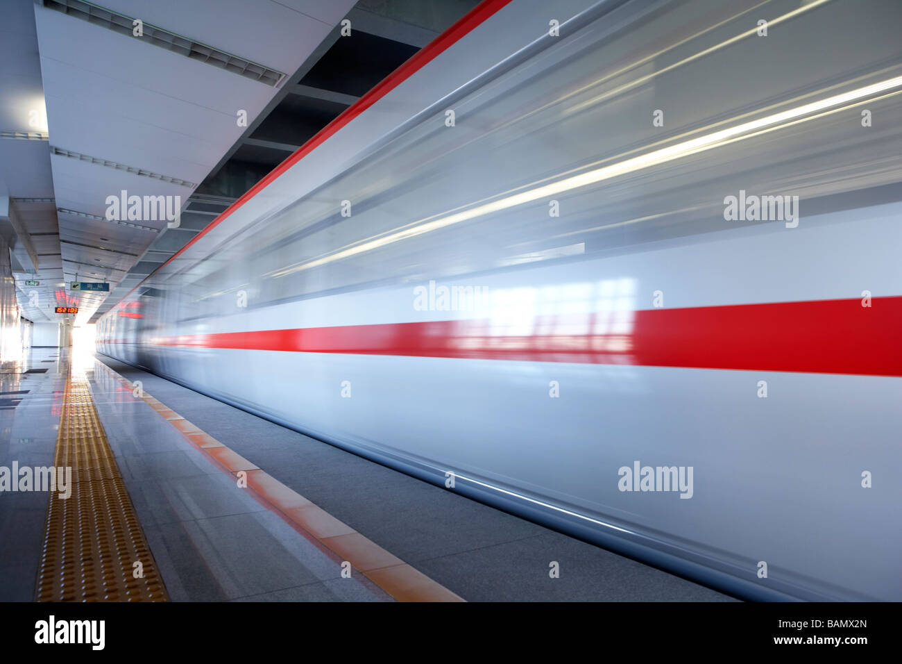 Subway Train Speeding Past Platform Stock Photo