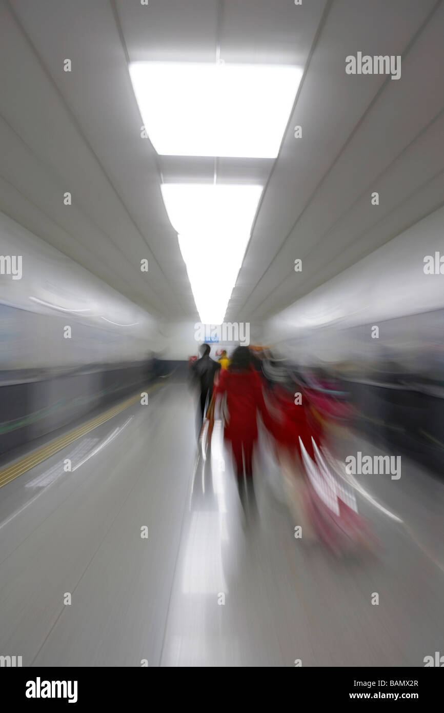 Blurred Image Of People On A Subway Platform - Stock Image