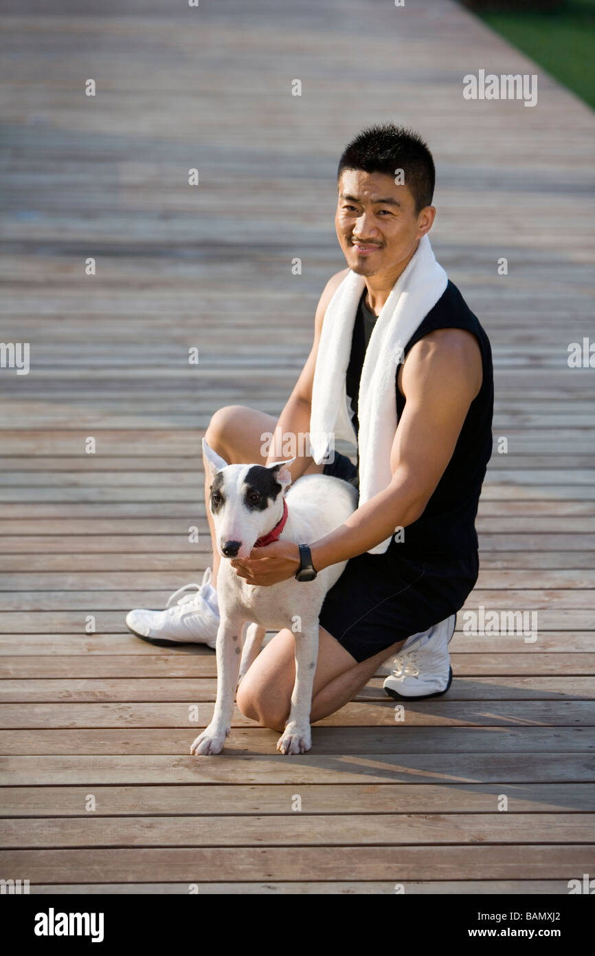 Athletic Man With Dog - Stock Image