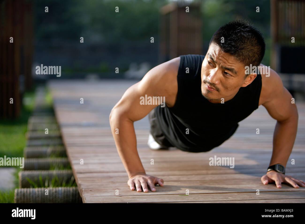 Man Doing Push-Ups - Stock Image