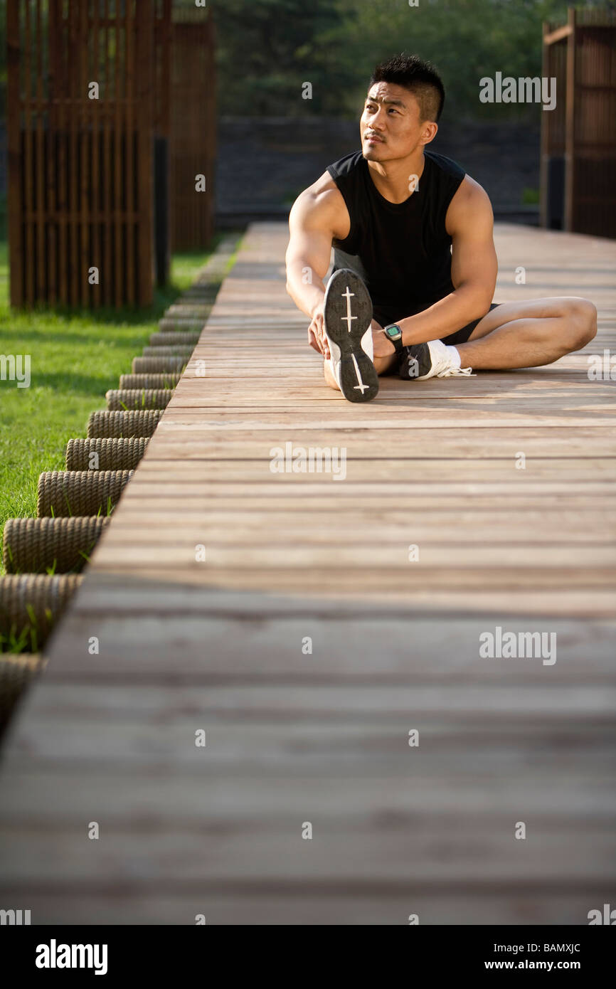 Man Doing Stretches - Stock Image