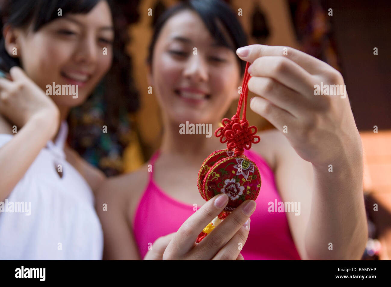 Two young friends shop for souvenirs - Stock Image