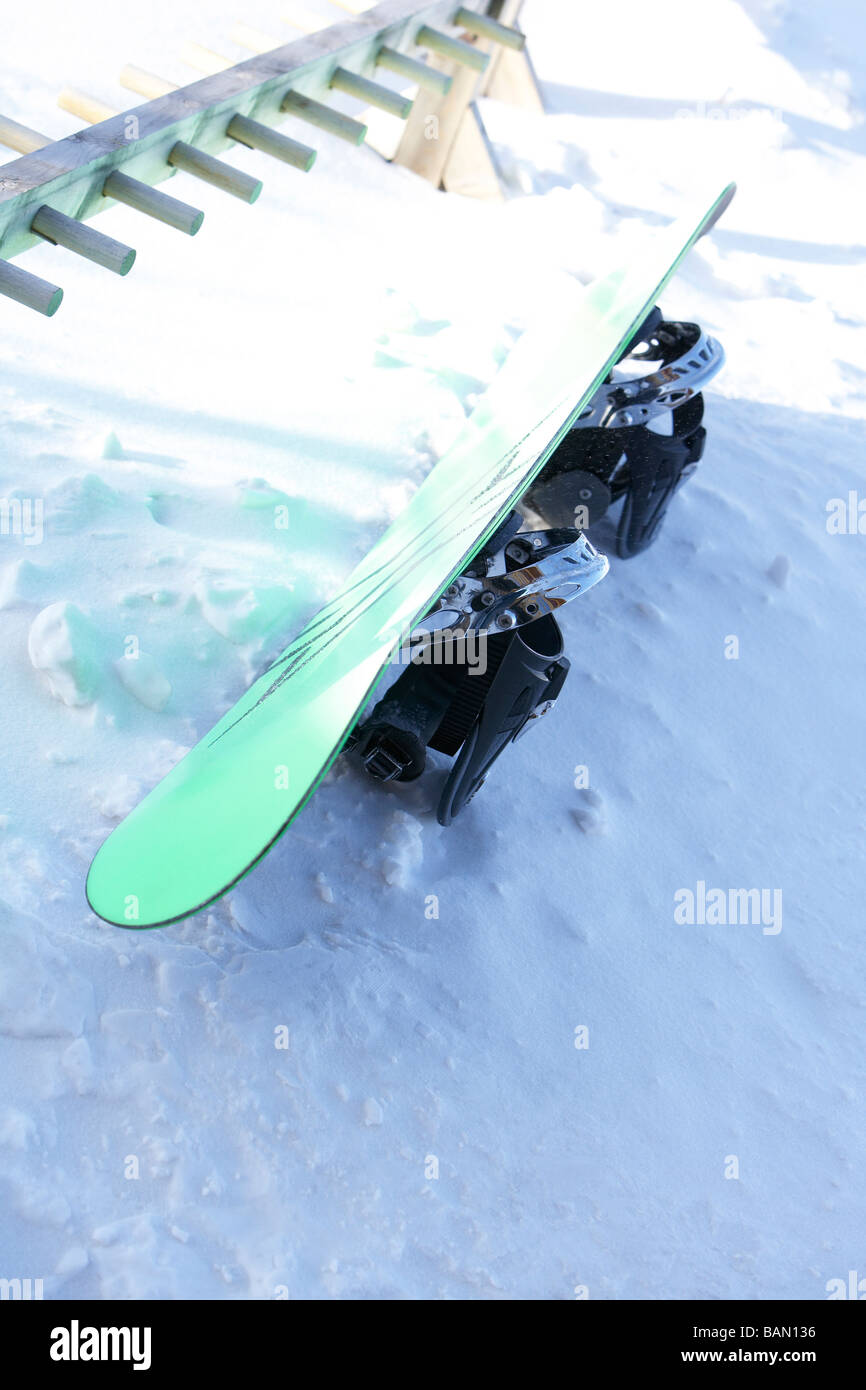 Snowboard in the snow - Stock Image