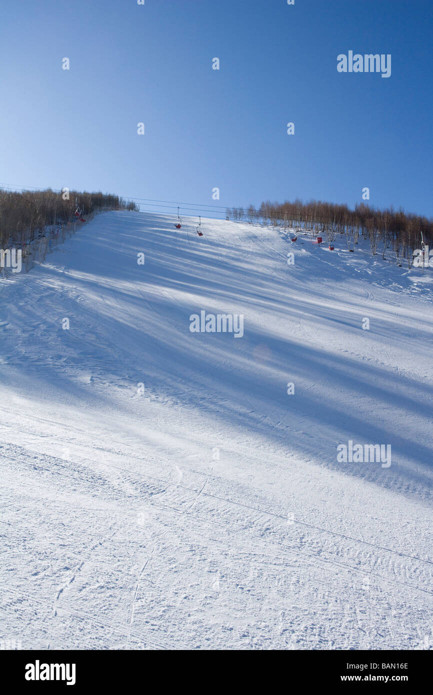 View of a ski lift in the distance - Stock Image