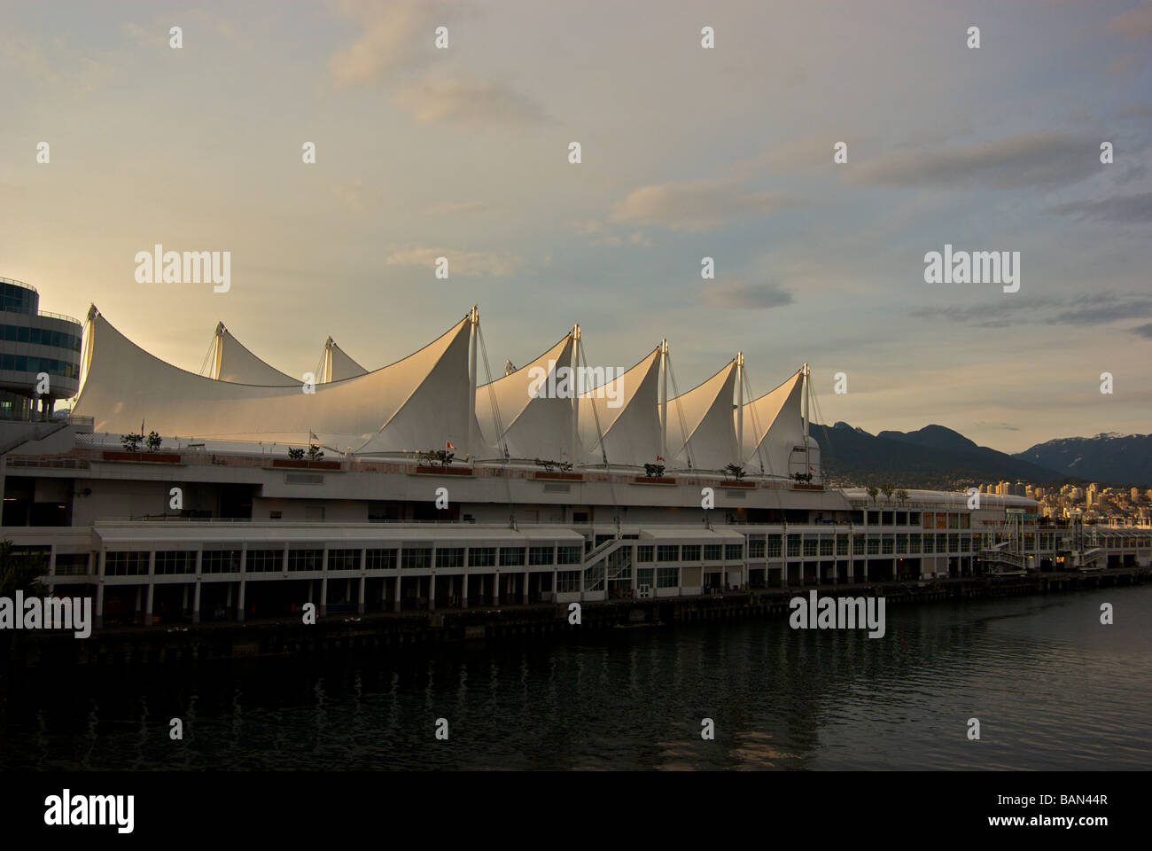 Teflon sails glow in warm setting sun at Canada Place Vancouver Trade and Convention Centre - Stock Image