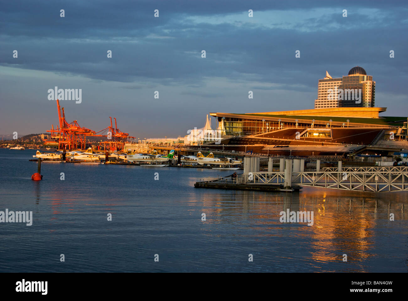 New Vancouver Trade and Convention Centre Extension and busy harbour in glow of setting sun - Stock Image