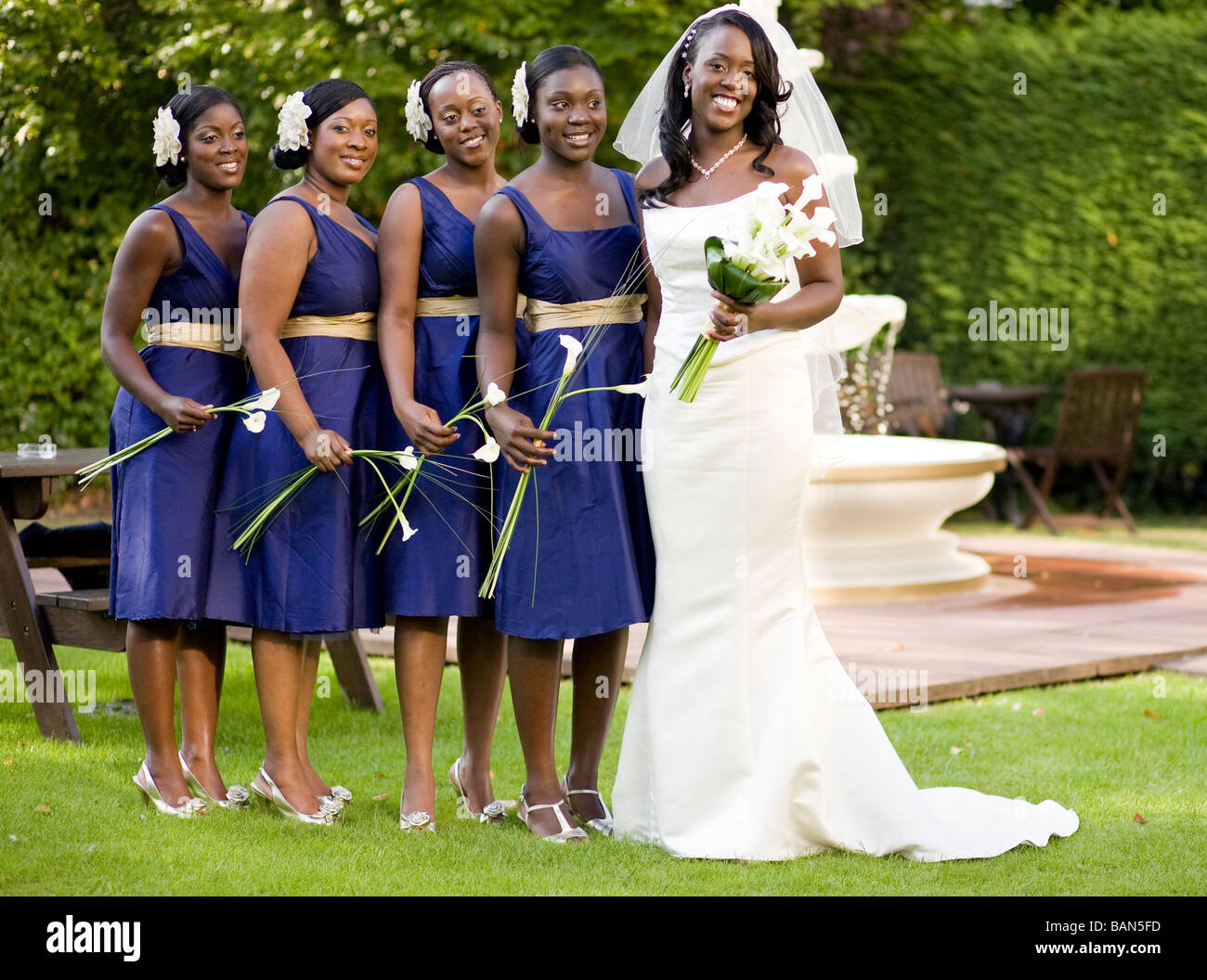 A Bride With Her Four Bridesmaids Pose For Photos At A Wedding In