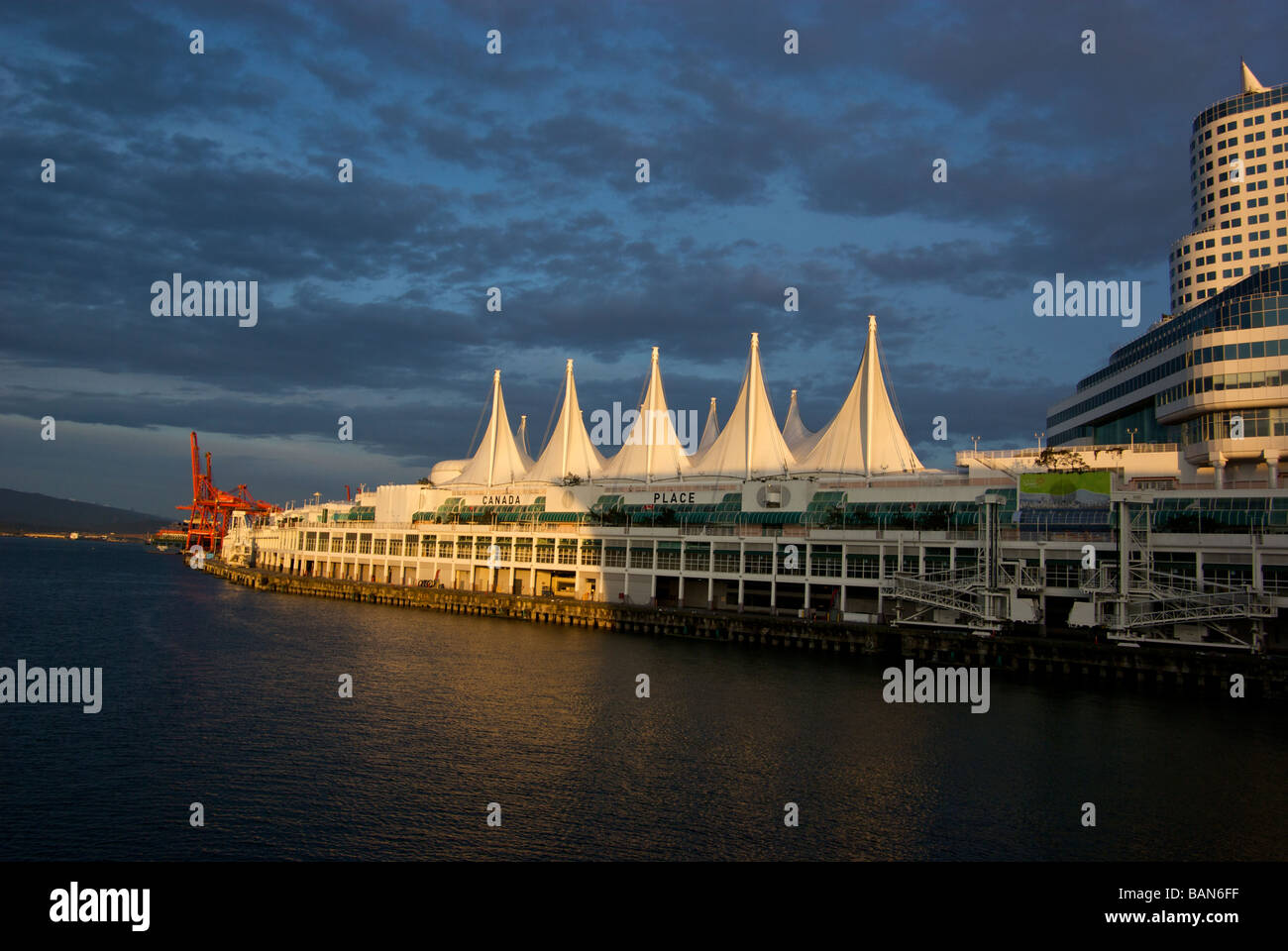Teflon sails of the Canada Place Vancouver Trade and Convention Centre glow in the setting sun - Stock Image