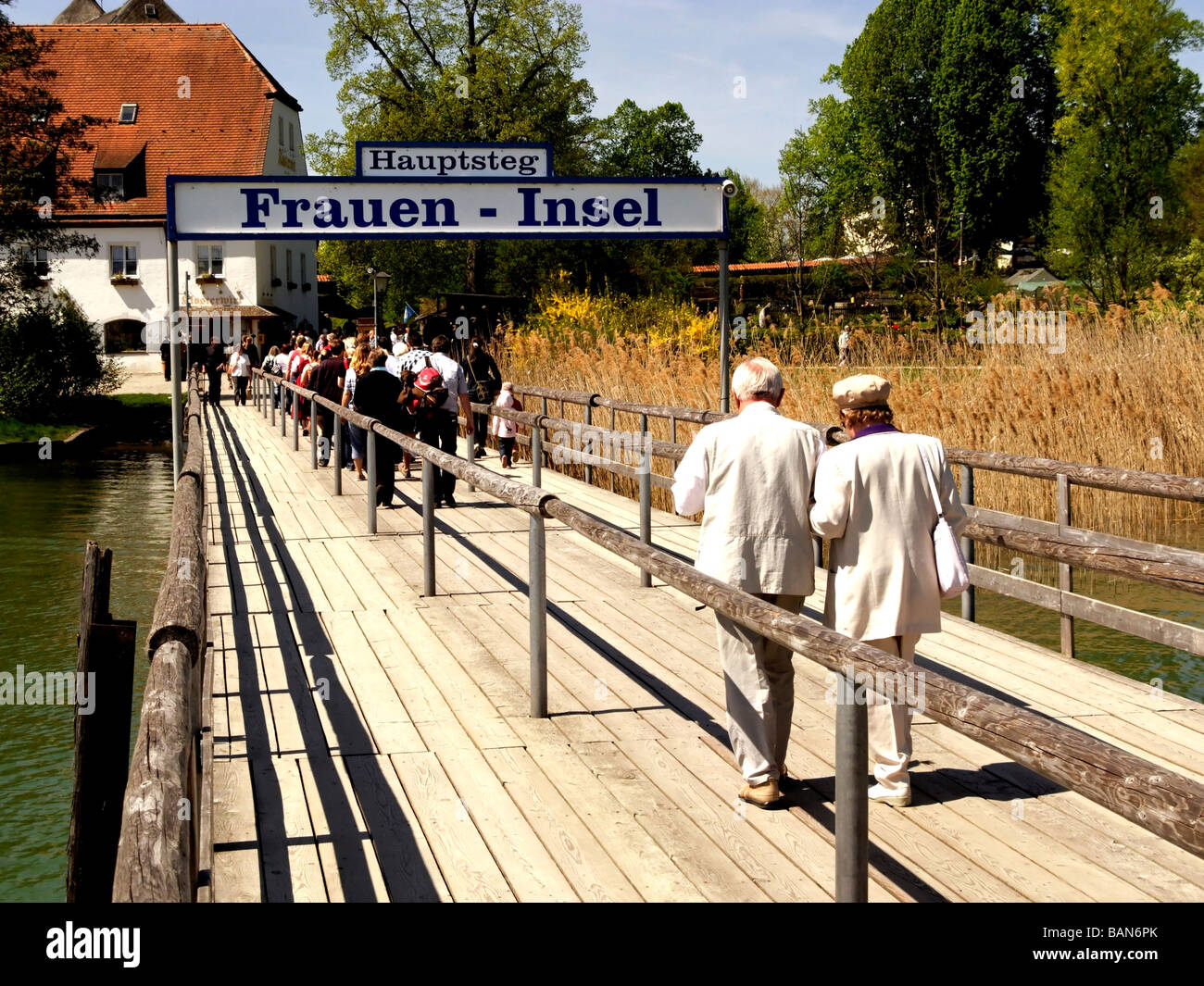 Tourists Arriving on the Fraueninsel Chiemsee Chiemgau Bavaria Germany - Stock Image