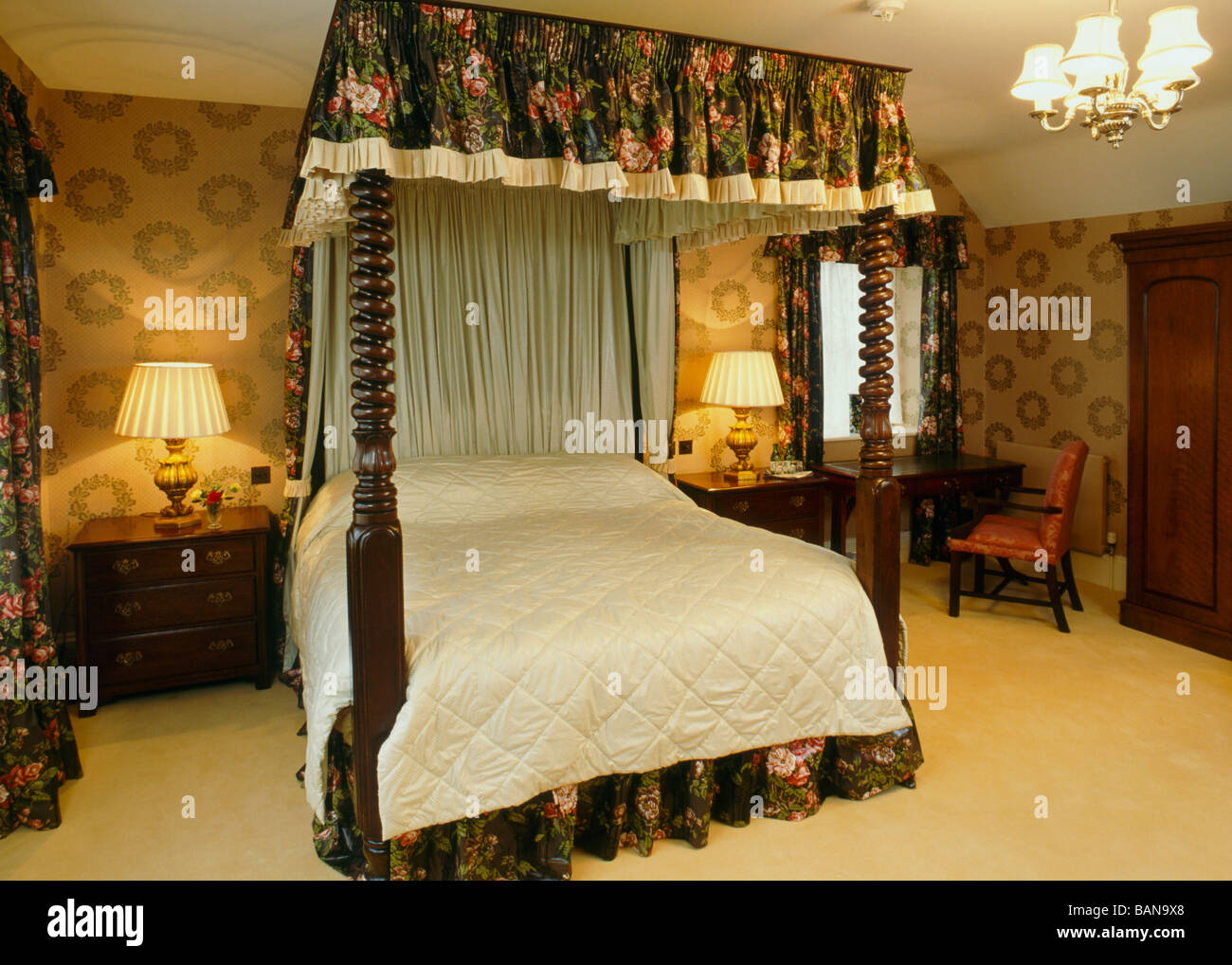 Bedroom with a large traditional four poster bed - Stock Image