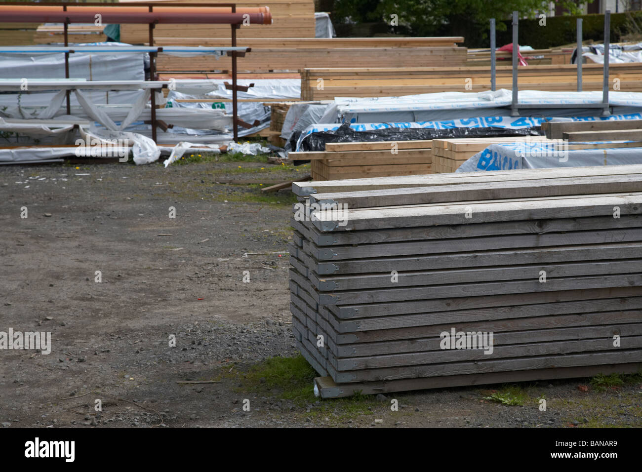 pile of wooden scaffold ended timber in a builders merchants yard - Stock Image