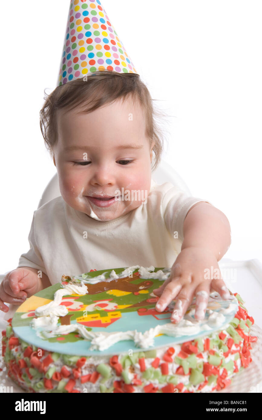 One Year Old Girl With Party Hat And Birthday Cake