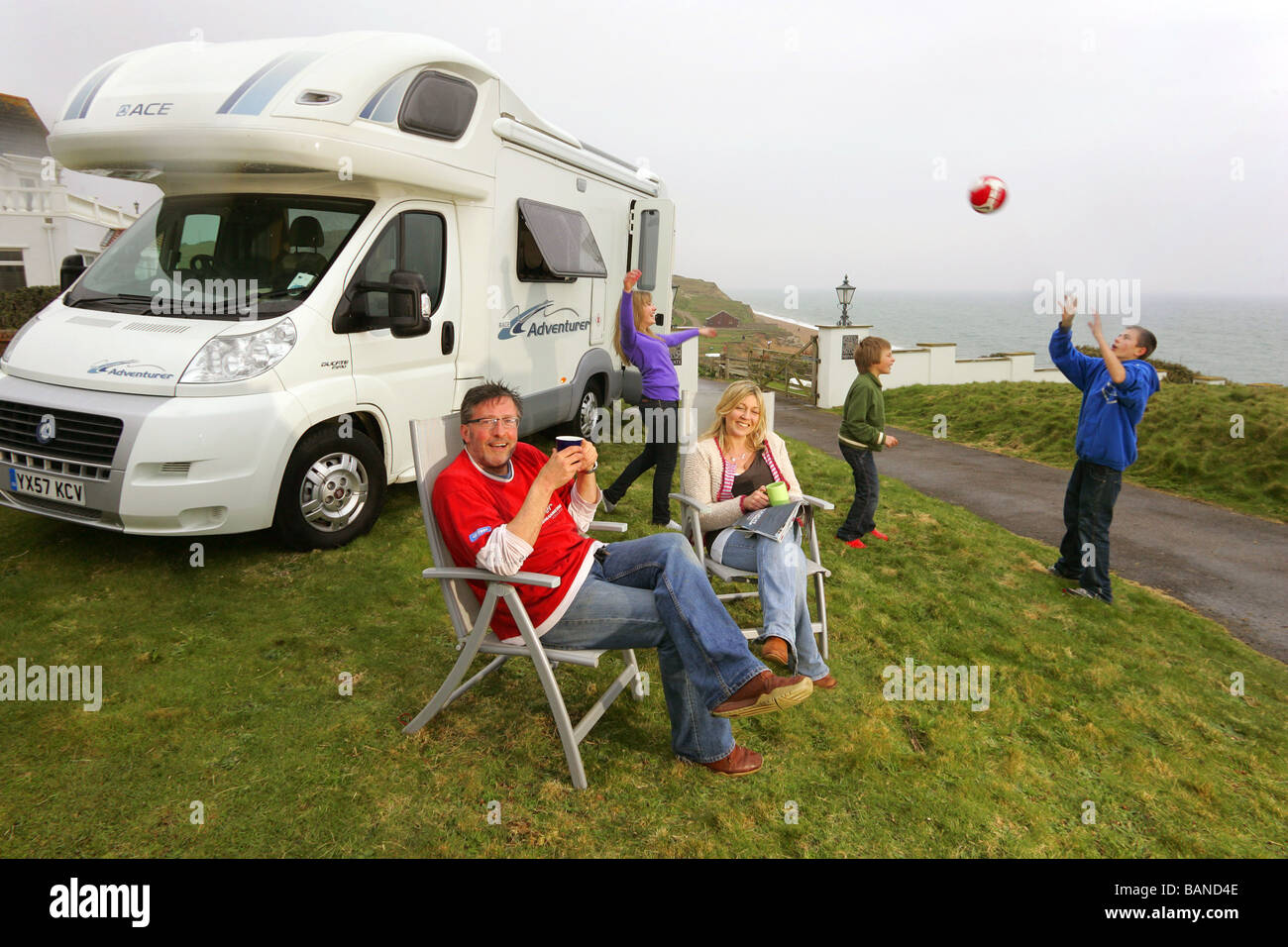 Comedian Rowland Rivron and family enjoying a motorhome holiday. - Stock Image