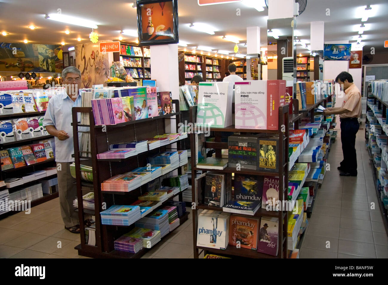Vietnamese people shopping in a bookstore in Ho Chi Minh City Vietnam - Stock Image