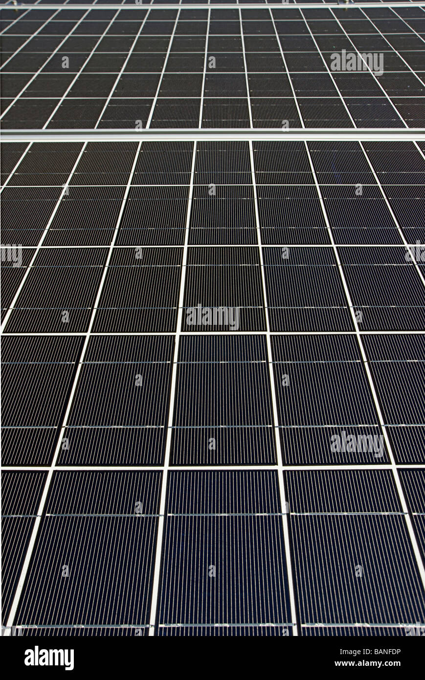 Photovoltaic solar panels mounted on a roof - Stock Image