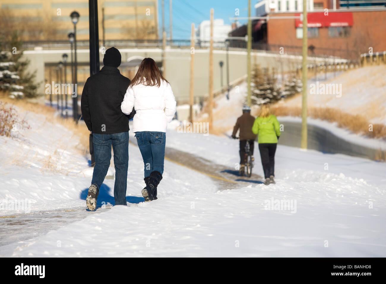 Edmonton, Alberta, Canada; Two couples walking on a path - Stock Image