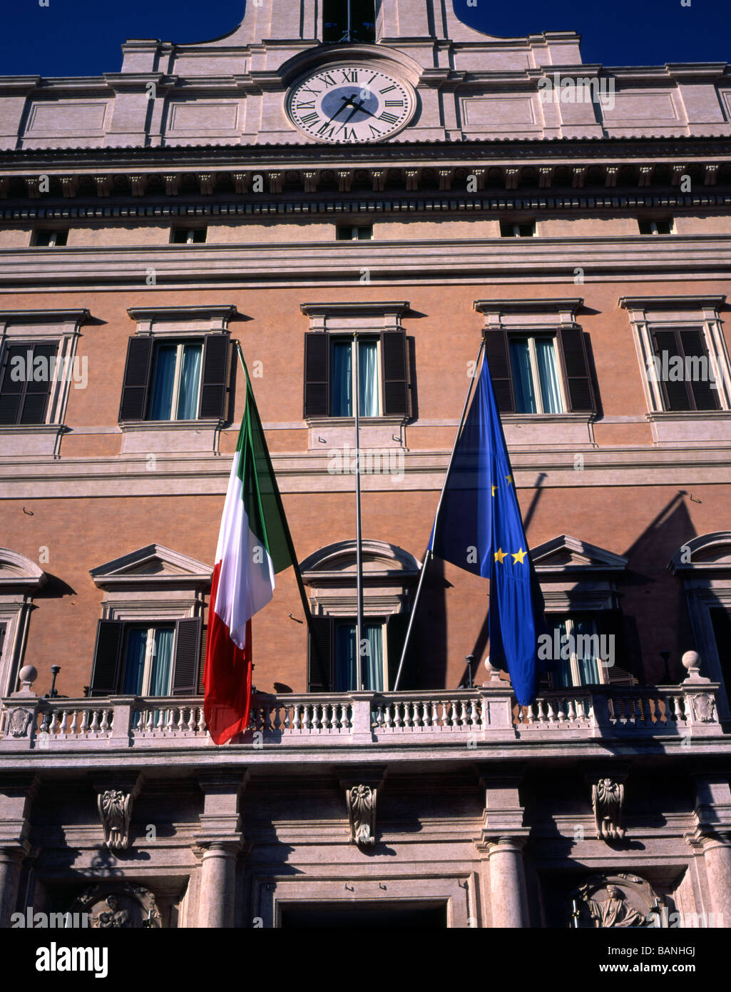 Italian and European Union Flags flying above the rear entrance to The Italian Parliament, The Palazzo di Montecitorio, - Stock Image