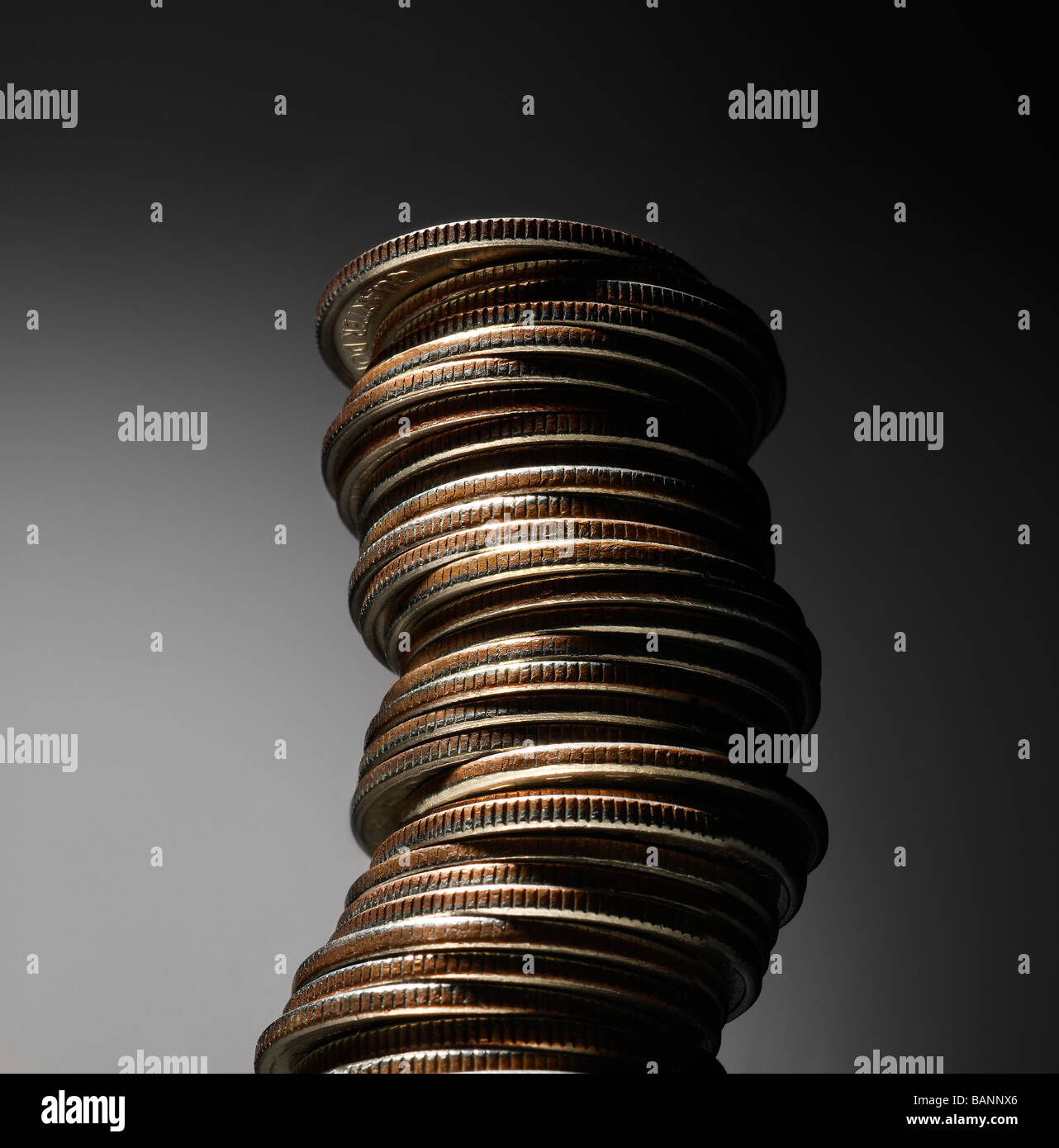 Side Angel Shot of Single Stack of Quarters - Stock Image