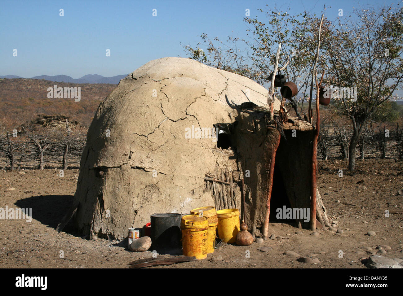 Traditional Himba Hut In Village (Kraal), Kunene River, Namibia, Africa - Stock Image