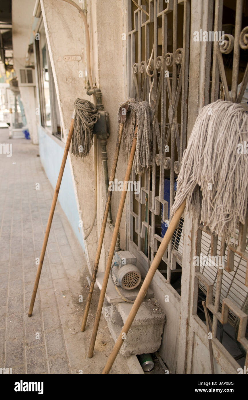mops drying outside an arabic rfesidence in the centre of Doha - Stock Image
