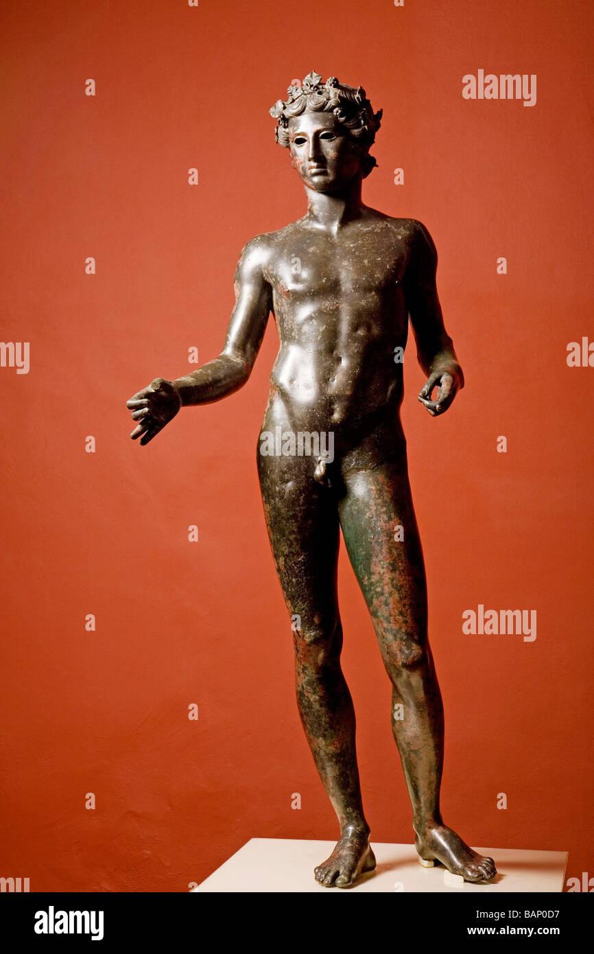 Roman Bronze Sculpture of El Efebo Municipal Museum Antequera Málaga Andalusia Spain - Stock Image