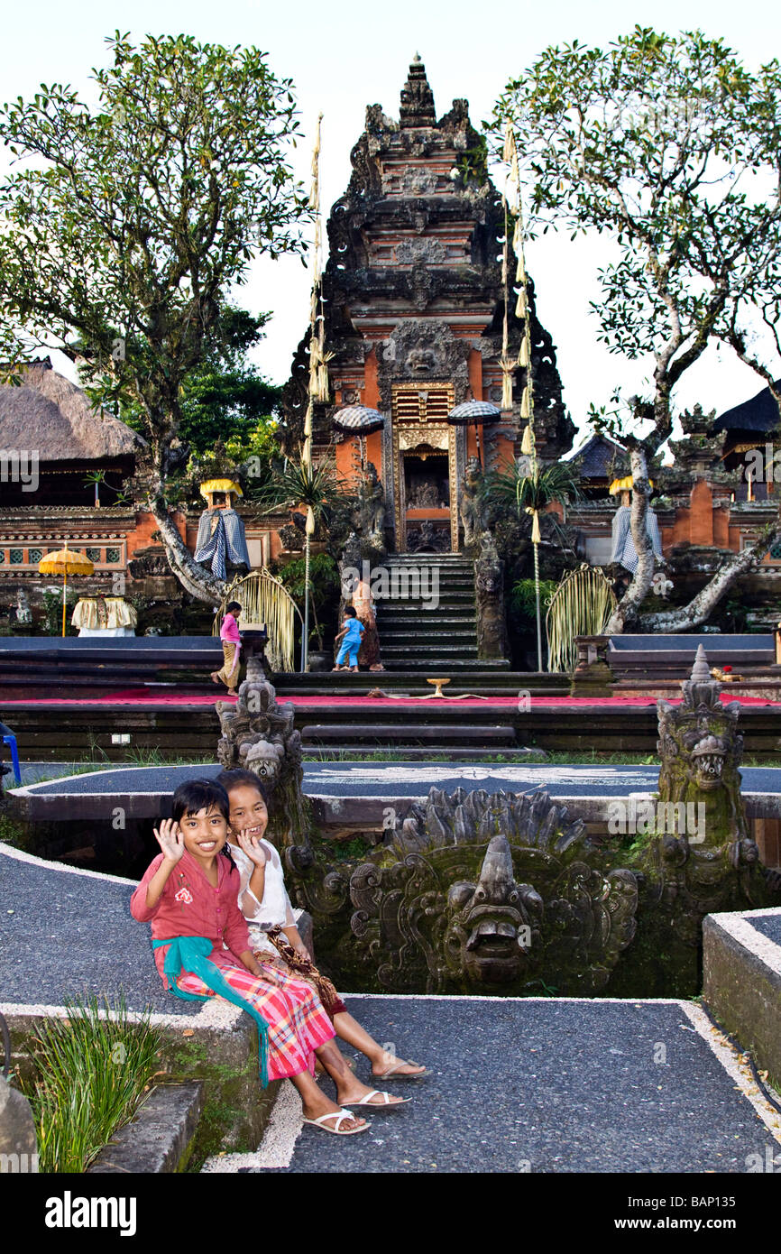 Twi little girl friends at temple in Ubud Bali Indonesia - Stock Image