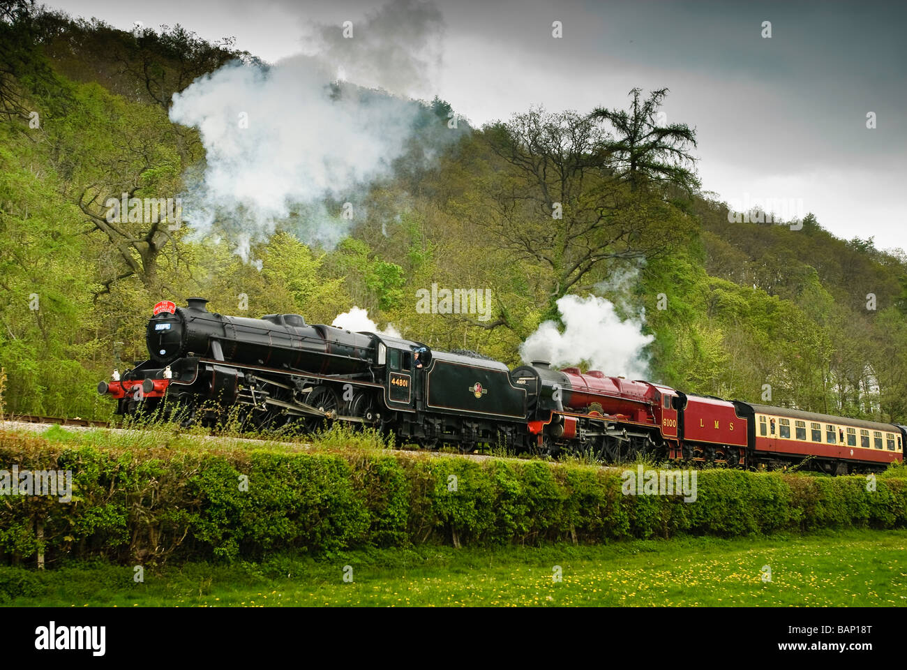 The engine Royal Scot Ex LMS 4 6 0 No 6100 built in 1930 double headed with a Stanier Black 5 loco No 44801 - Stock Image