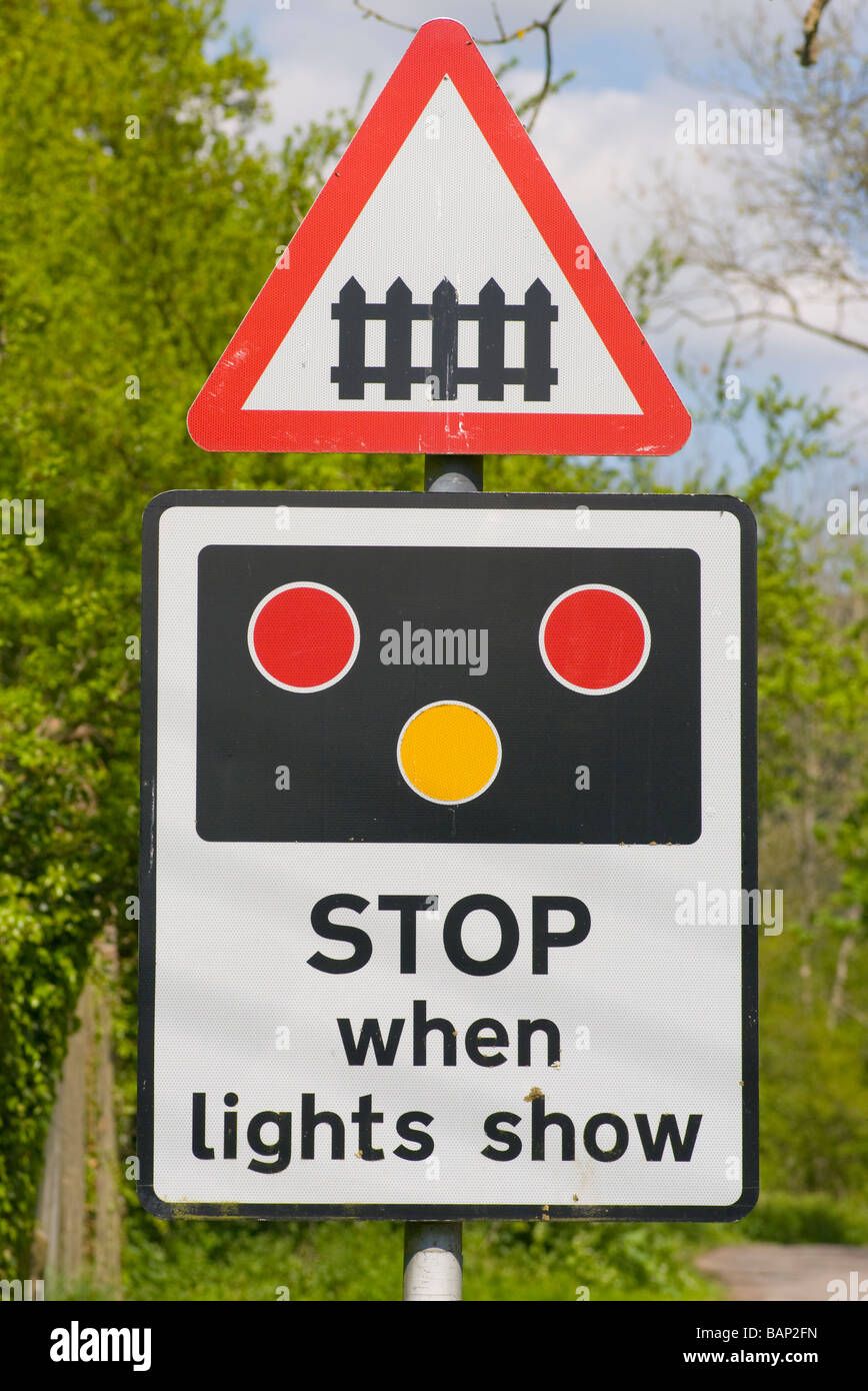 Railway Train Level Crossing Stop When Lights Show UK Road traffic Sign Signs roadsigns roadsign - Stock Image