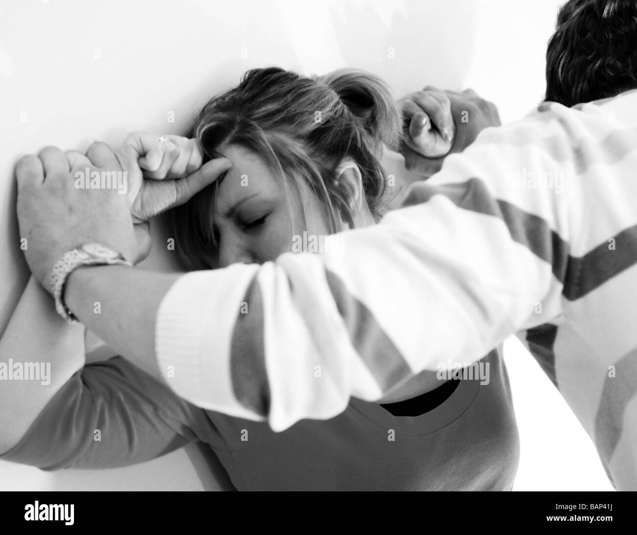 Young male physically abusing a young woman in their twenties - Stock Image