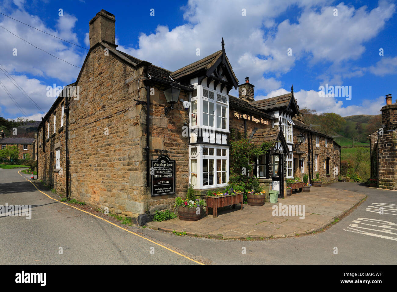 The Old Nags Head pub start of the Pennine Way at Edale, Derbyshire, Peak District National Park, England, UK. - Stock Image