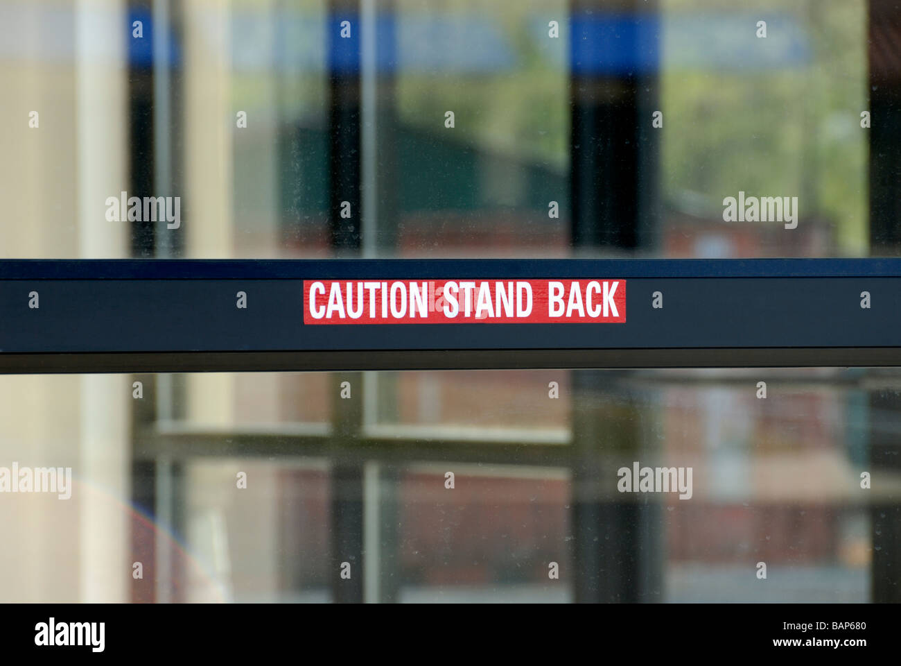 Caution Stand Back Sign On Automatic Door Stock Photo