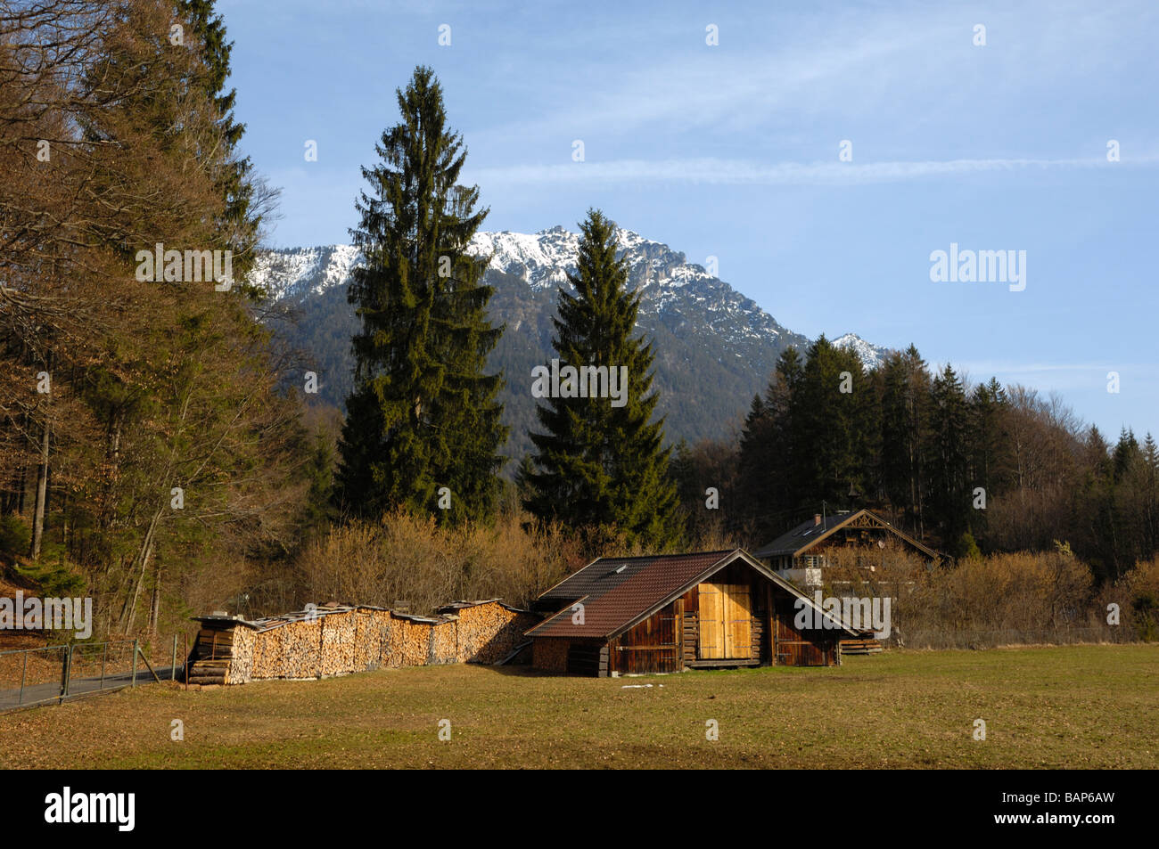 Typical barn and wood stack, Grainau, near Garmisch-Partenkirchen, Bavaria, Germany - Stock Image