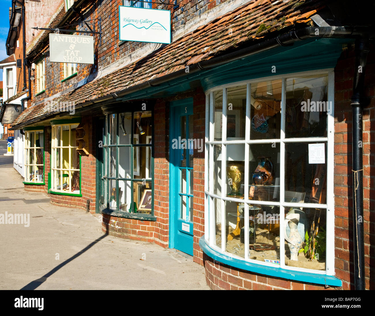 A row of quaint old bow fronted shops in the typical English market town of Marlborough Wiltshire England UK - Stock Image