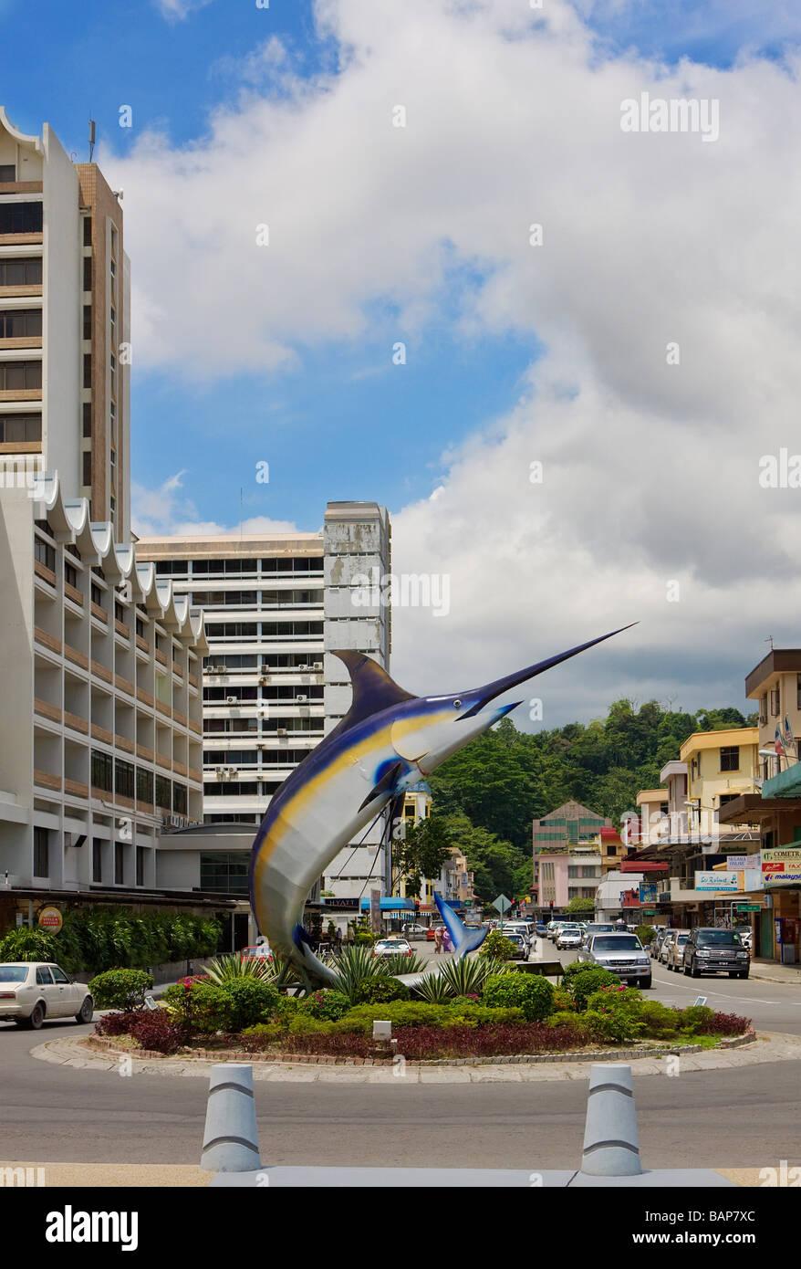 City street and fish sculpture Kota Kinabalu Sabah Borneo - Stock Image