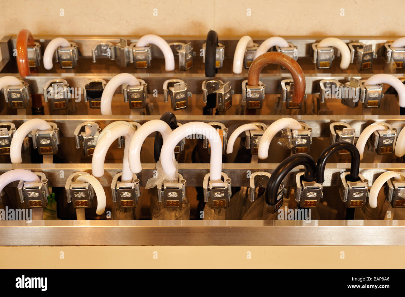 An umbrella locker in front of a hotel lobby, Kyoto JP - Stock Image