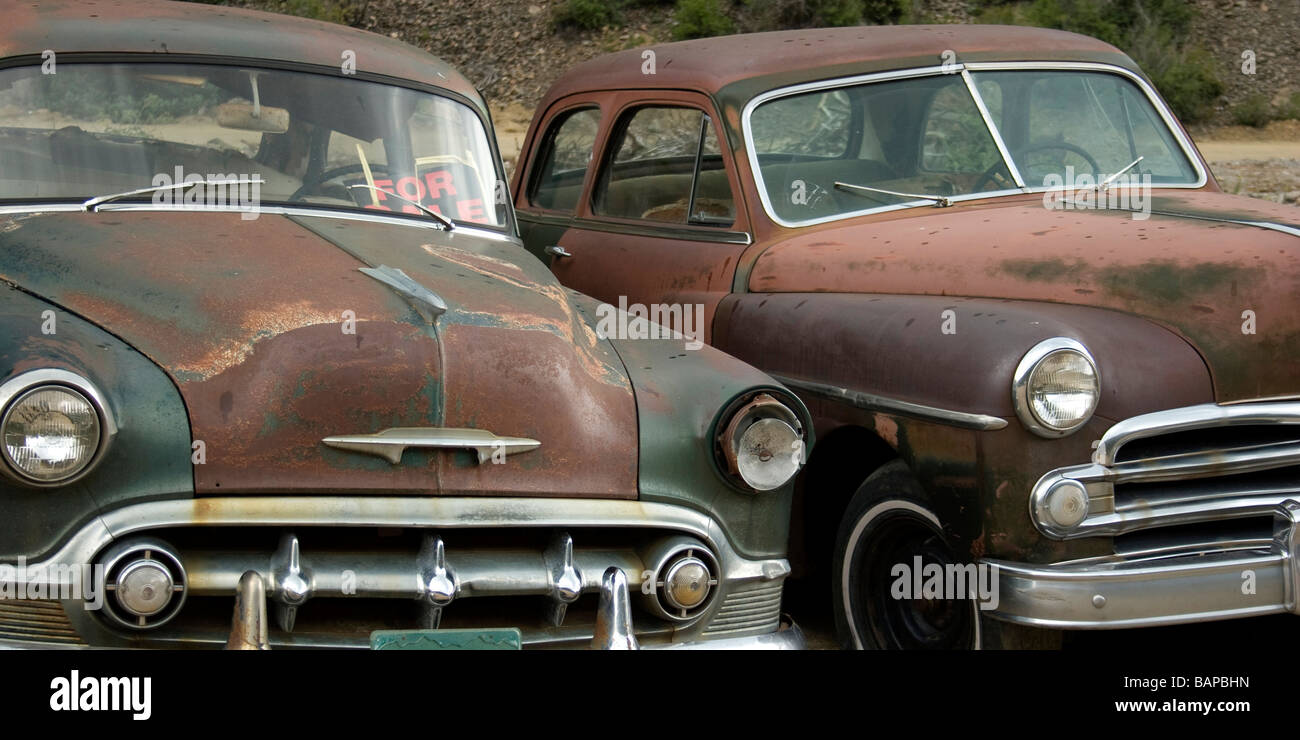 Old rusted cars at the junkyard looking sad. For Sale sign Stock ...