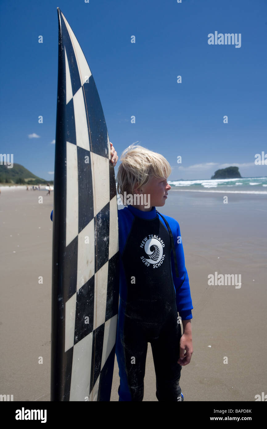 Boys Surfing in Mt. Mauganui New Zealand - Stock Image