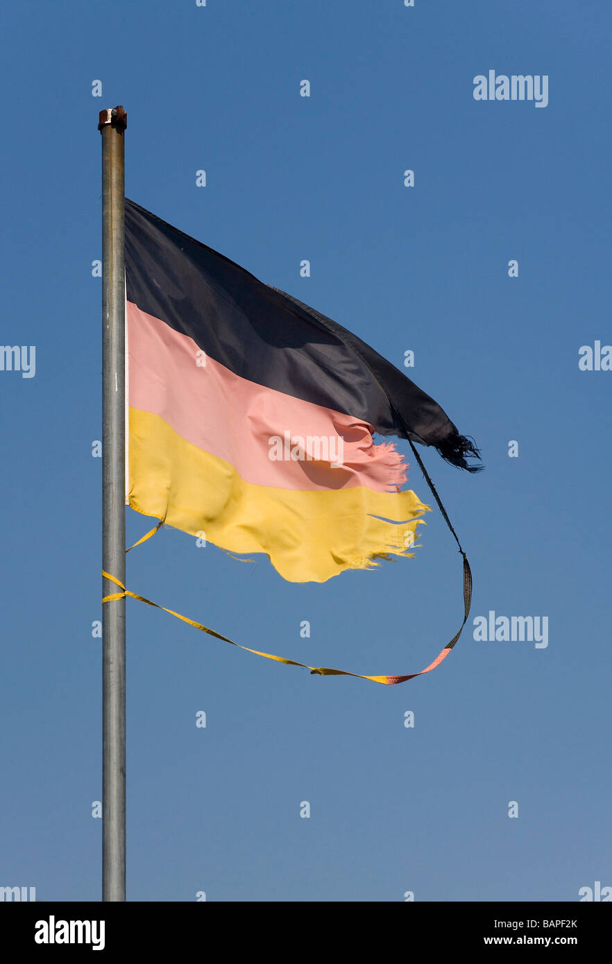 Torn German flag - Stock Image